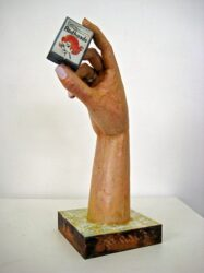 Hand with matchbox