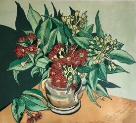 Red flowering gums in a pewter jug