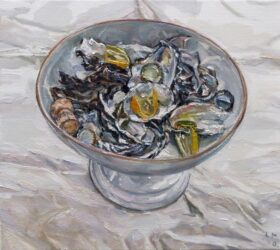 Oyster shells and lemon in bowl