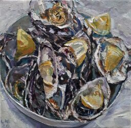 Oysters and lemons in a bowl