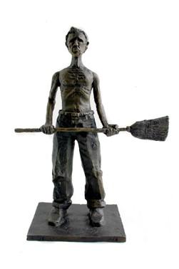 Skinny man with a broom