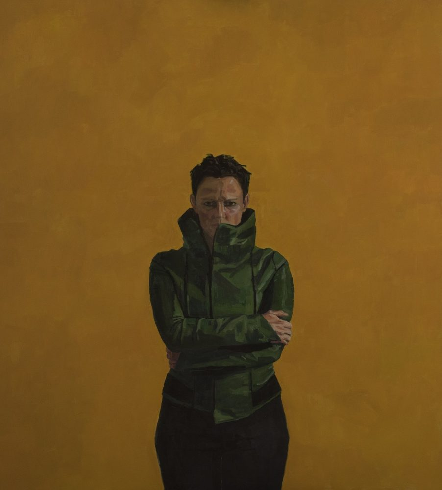 Green leather coat on yellow