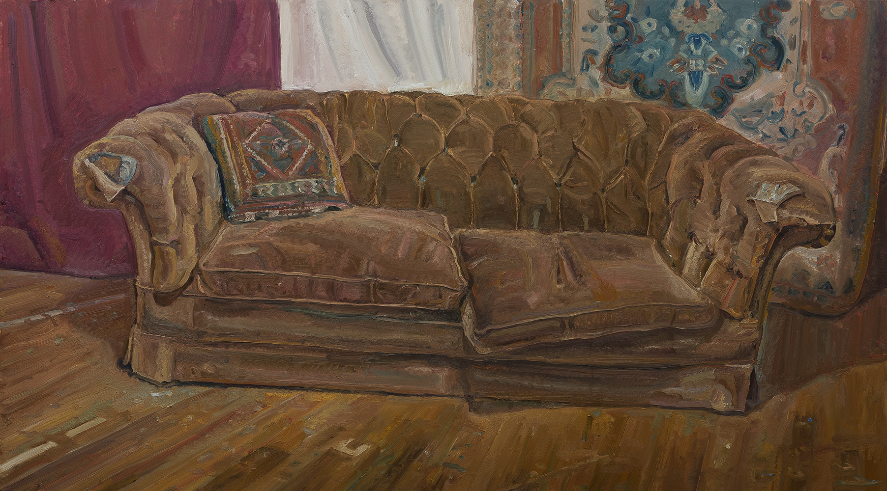 Brown couch and tapestry cushion