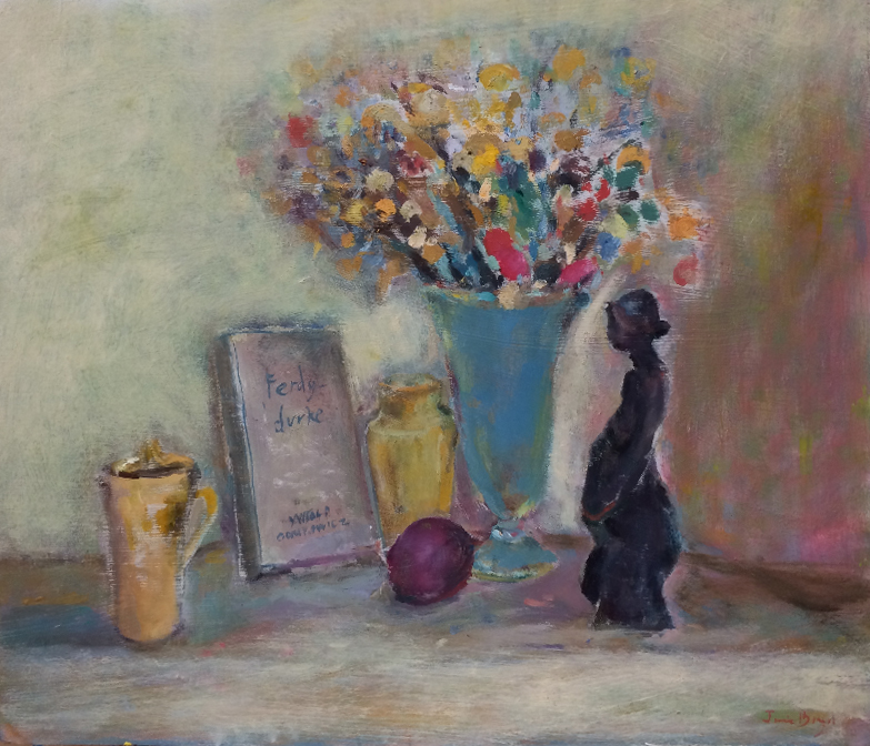 Vase of flowers with sculpture and book